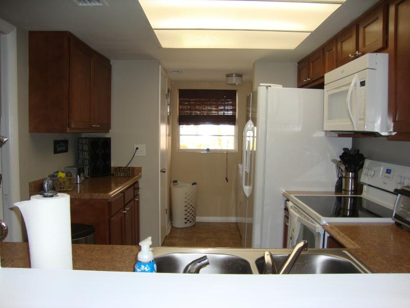 Fully equiped kitchen and a separate pantry for food