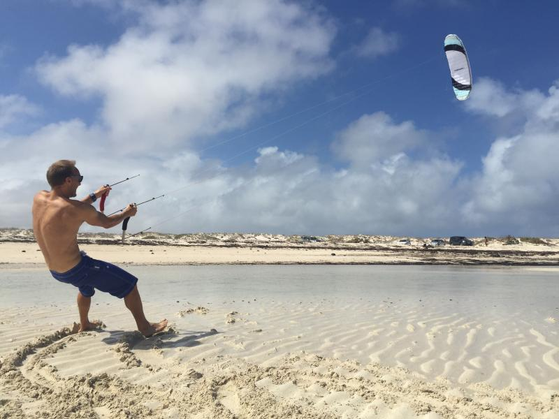 Playing with the kite at the lagoon near El Cotillo.