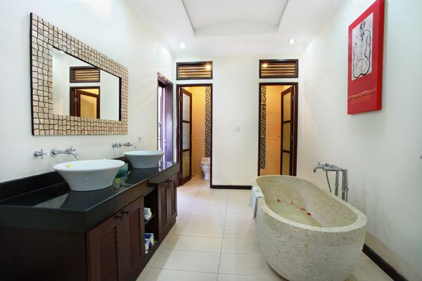 En-Suite Bathroom with marble bathtub