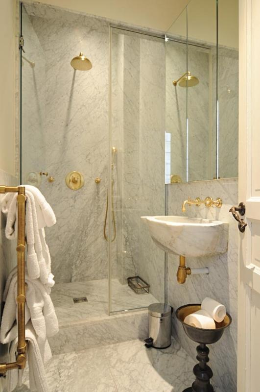 Second marble bathroom with shower, sink and toilet
