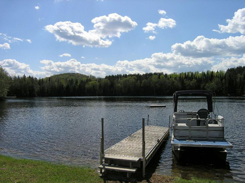 Wade into the cool refreshing water from the sand-bottomed beach or jump in from the dock.