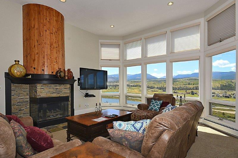 Large picture windows with mountain and valley views