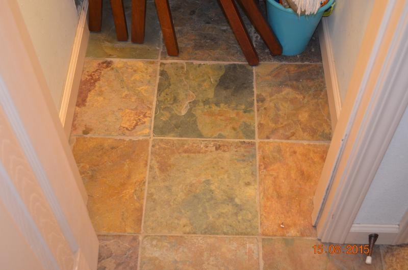 Cleaning Supplies Closet Stone Floor by the Front Door