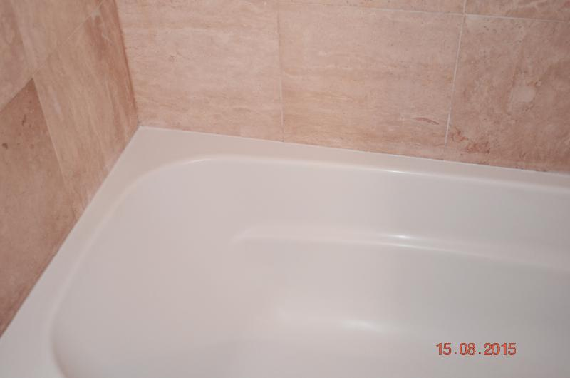 Upstairs Bathroom Natural Stone and Bathtub