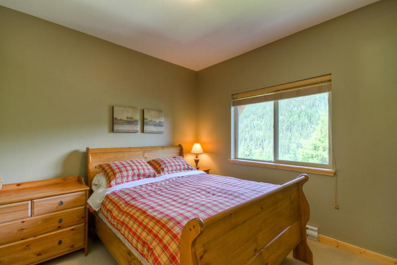 Main floor queen bedroom one with views to Mt Todd and Sun Peaks runs
