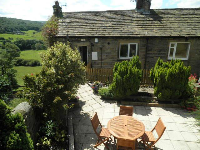 This Listed Weaver's cottage is now a comfortable holiday base with a private garden and great views