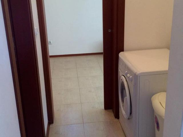 Utility area with washer/dryer.
