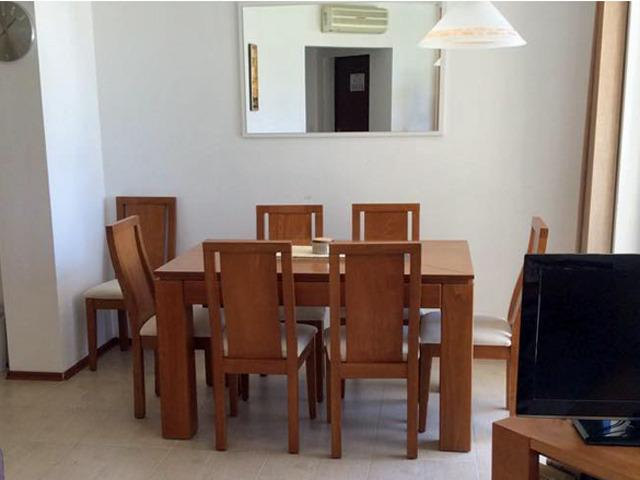 Dining table and 8 chairs (1 not shown).