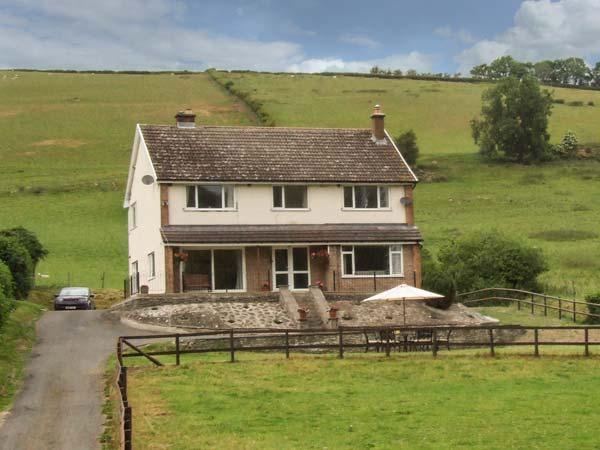 CWMGILLA FARM, detached farmhouse, woodburner, hot tub, WiFi, stunning views, holiday rental in Dulas