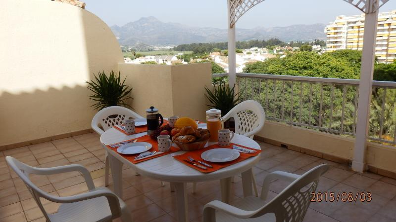 Breakfast on the terrace with mountain views.