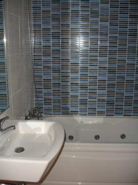 modern well finished bathroom with bidet & whirlpool bath