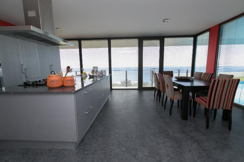 Modern kitchen, with sea view and pool.