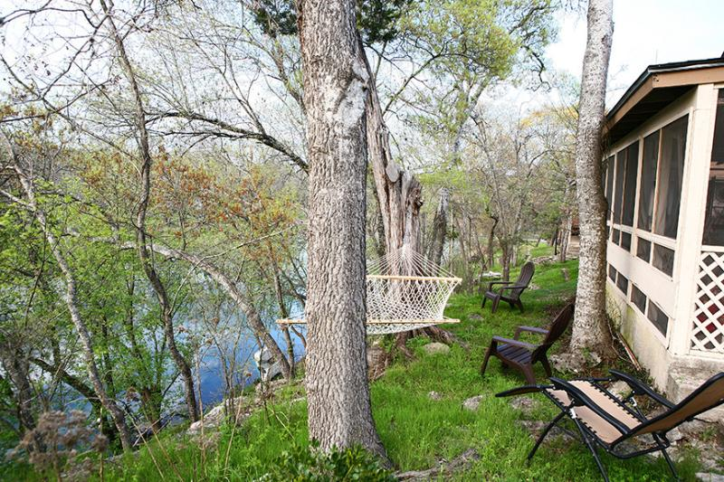 Swinging on a screened in porch having coffee overlooking beautiful Cypress Creek.