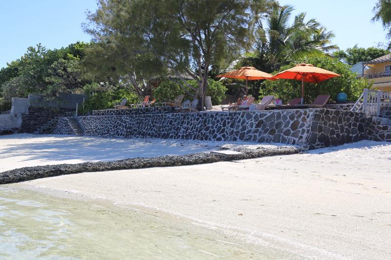 Sunbeds on the beach side (left side)