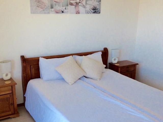 Master bedroom with Kingsize bed, wardrobe and balcony.