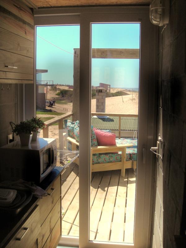 La Amistad Cottages #3 Kitchen and Deck