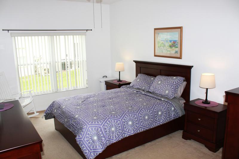 Queen bedroom with flat screen and attached bath