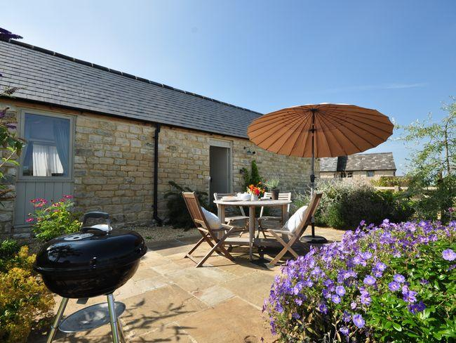 View towards the barn with enclosed garden and seating