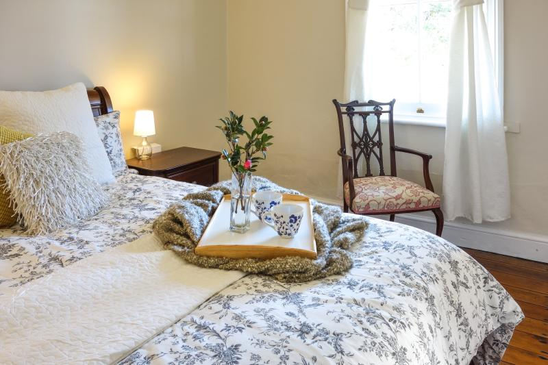 The main bedroom has a gorgeous window facing North. This is a queen size bed with beautiful linen.