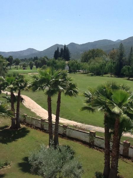 View from the upper terrace across the golf course and across to the mountains
