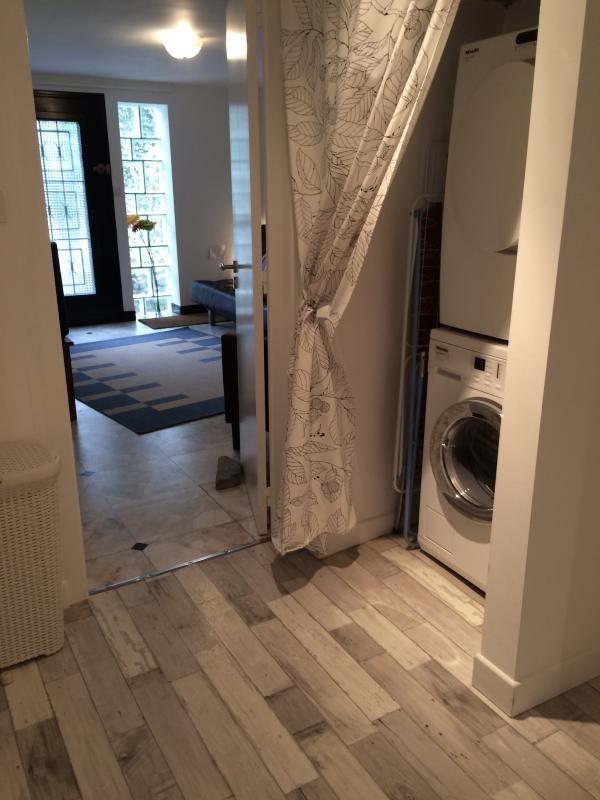 Corridor with Miele washing machine and dryer.