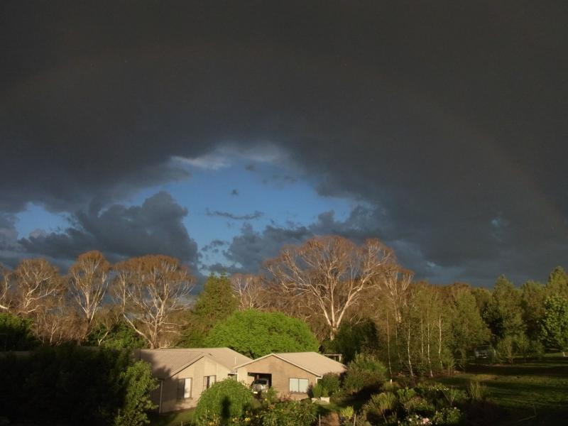 Rainbow and storm clouds over our house.