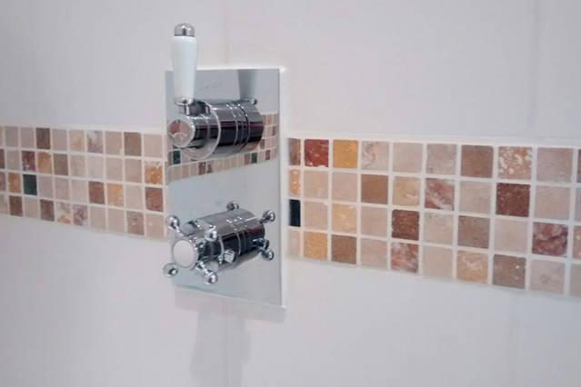 Thermostatic shower controls