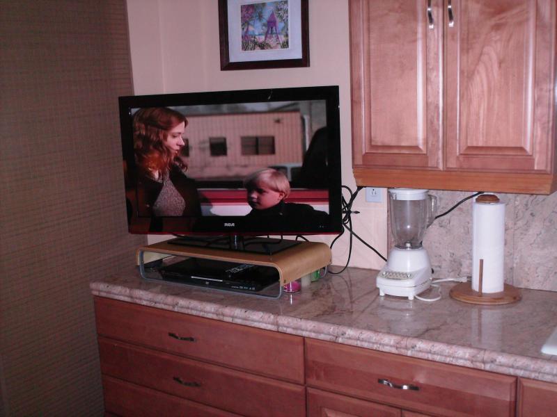 Flat panel tv con reproductor y películas de DVDs