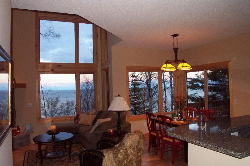 Dramatic floor to ceiling windows bring the sight and sounds of Lake Superior in, it's so beautiful!