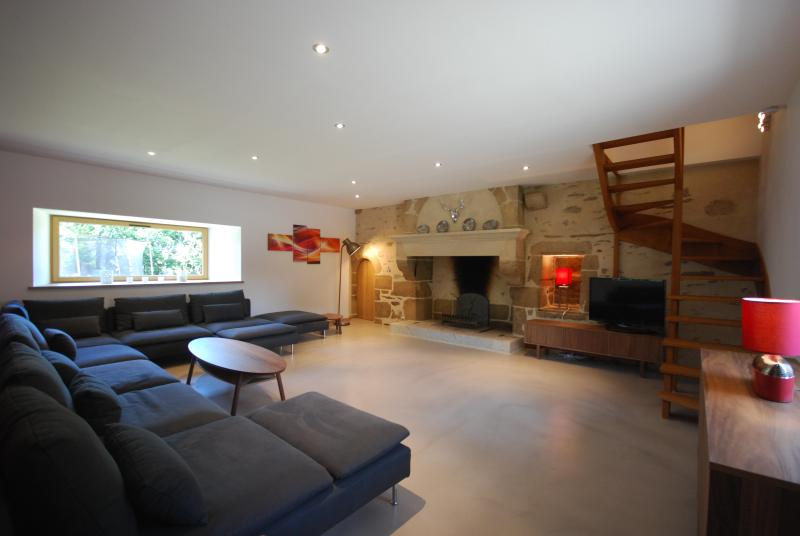 Main Lounge with beautiful open stone fireplace & 2nd staircase