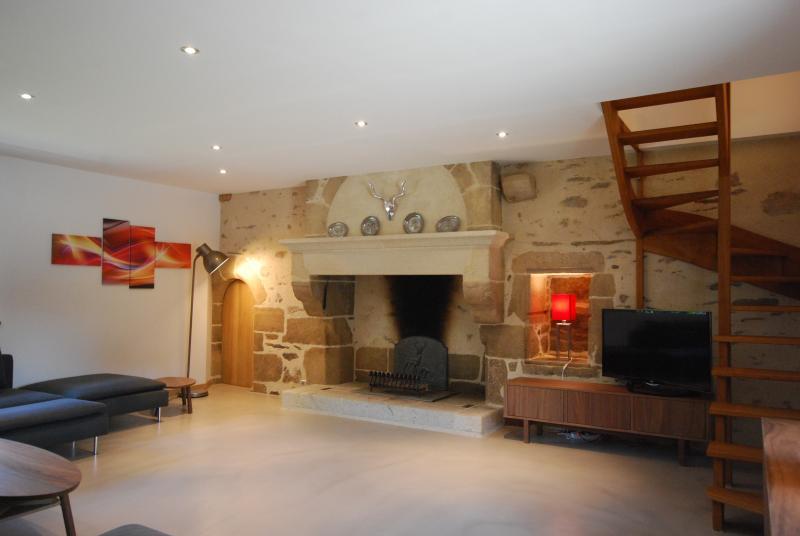 Main lounge with large sofa, polished concrete flooring & underfloor heating