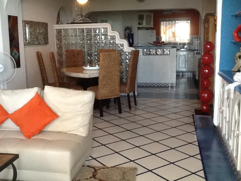 Spacious living area with dinning area with a gorgeous dinning room table that accommodates 6.