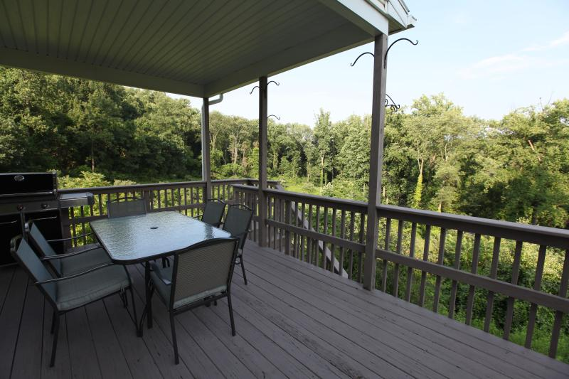 Deck with a grill and seating for 8