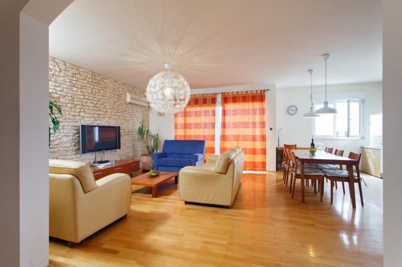 Large and cozy living room where you can enjoy in social time with your family or friends.