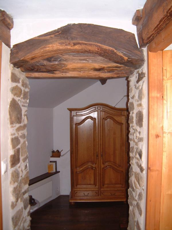 wooden beams and stonework are a feature of this room