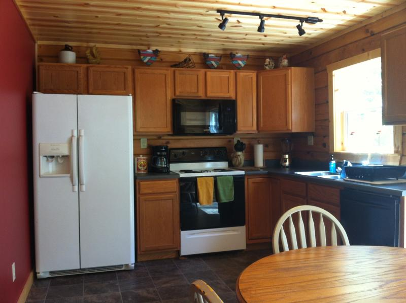 eat in kitchen-table seats 8 people-full fridge with ice maker-electric stove-microwave-dishwasher