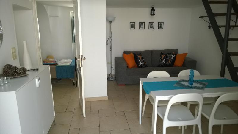 Lounge area with door through to single bedroom