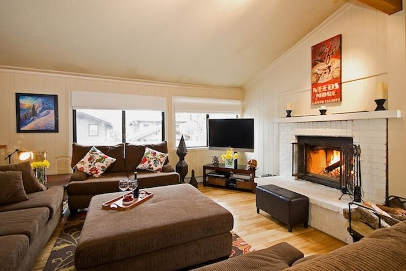 spacious seating for a dozen or more with big screen and warm fireplace.