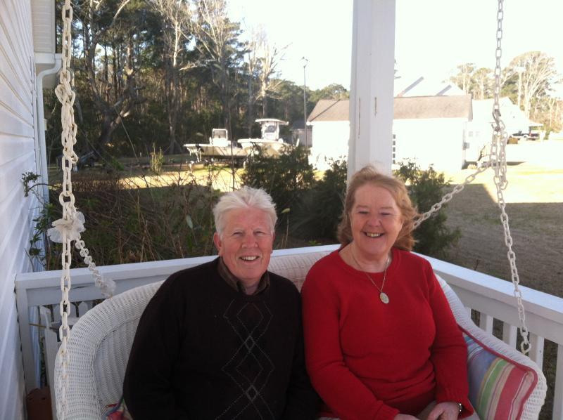 Friends enjoying the porch swing.
