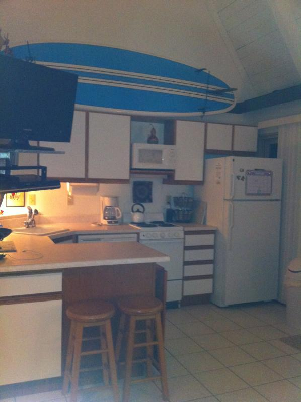 Bright kitchen with high celing and fan