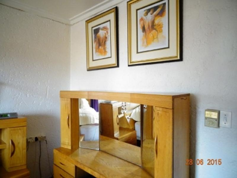 Purple main en-suite bedroom, hair dryer, dressing room, private balcony, flat screen TV, DVD player