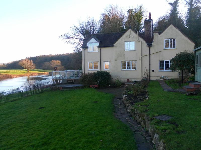 Malvern cottage rental - View of rear of property and garden showing proximity of river