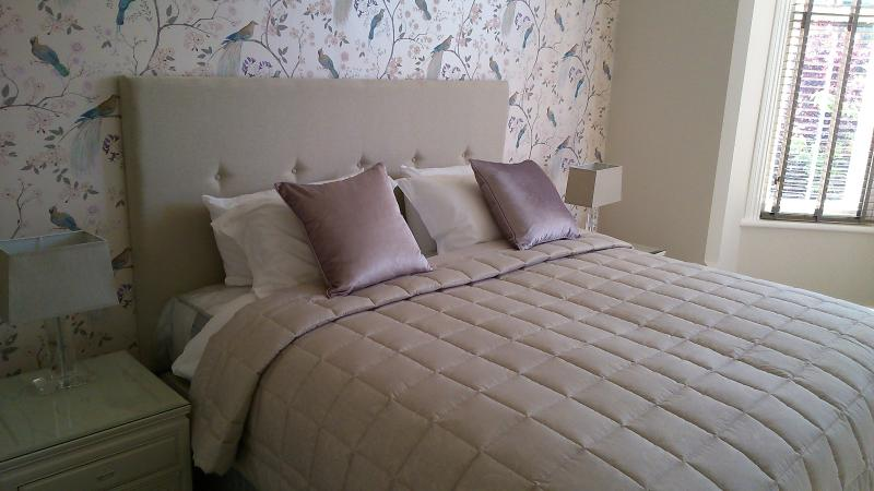 Queen-sized bed with Egyptian cotton sheets