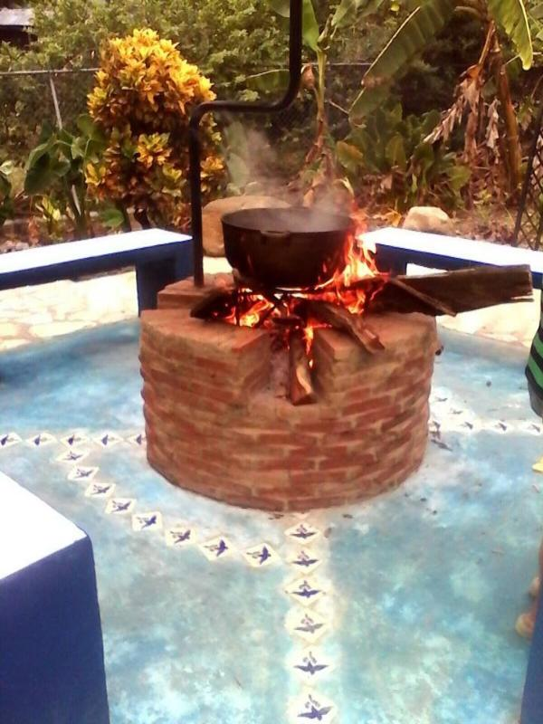 Sancocho (Dominican Stew) cooking over an open fire