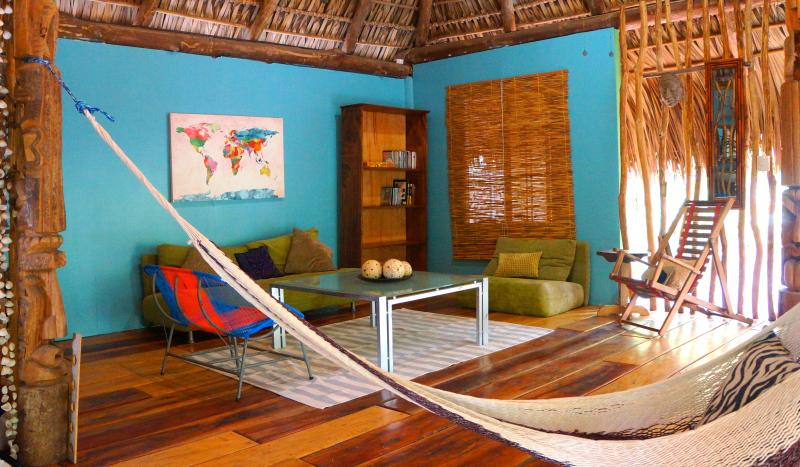 The open living space with woven frond roof provides a natural indoor/outdoor feel to your vacation