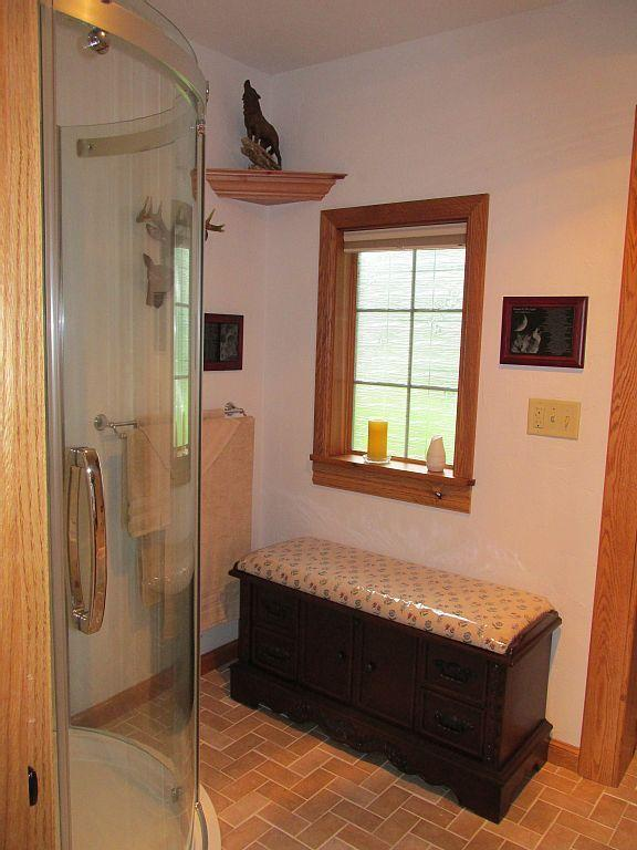 Over size shower with seating area.