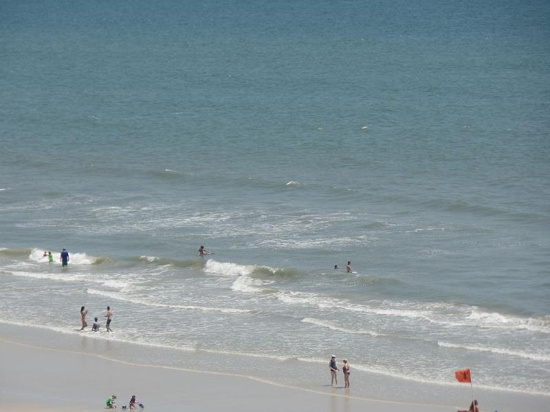 From our balcony, fun awaits on the sand and in the surf