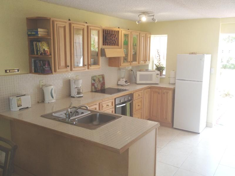 Well equipped open plan Kitchen with split level cooking. Laundry room off.
