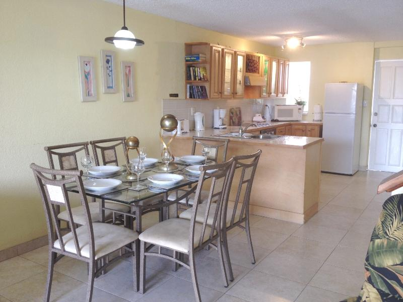 Open plan living showing dining area for 6 persons and well equipped kitchen.
