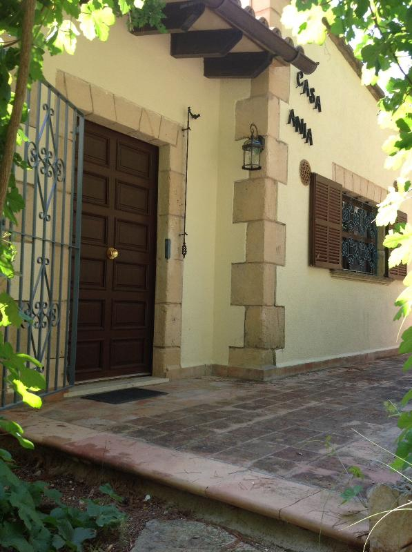 A traditional style villa with wrought iron work gates and bell signalling a warm welcome